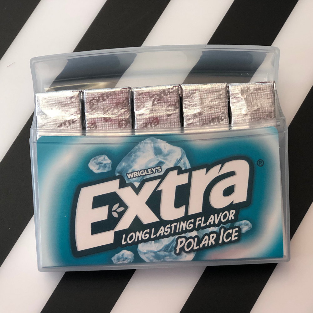 To make a storage case for your 30 affirmations, start with a plastic chewing gum container.